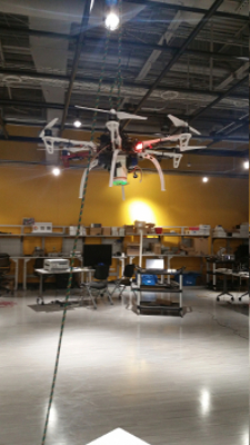 Figure 2: UAV hung from ceiling grid for wireless channel measurement using Alford Loop Reconfigurable Antenna